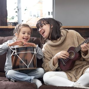 The-Rhythm-Tree-young-mother-and-daughter-play-musical-instruments-8LMWX27
